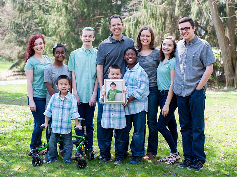 One dad, nine lives: Father, family find support at Michigan