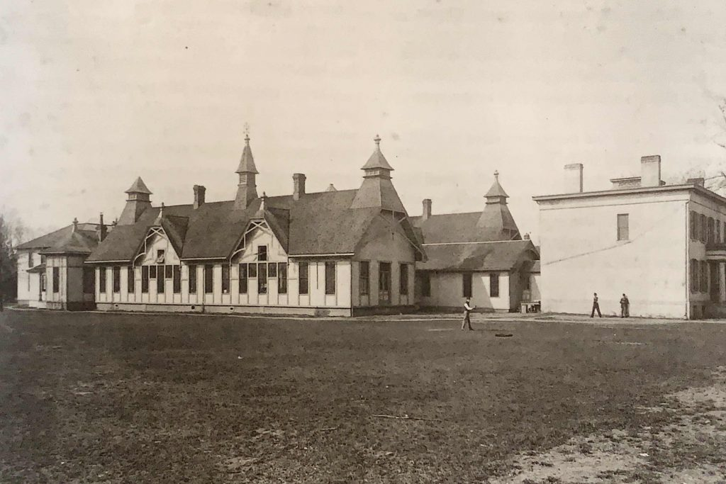 Black and white photo of old building.