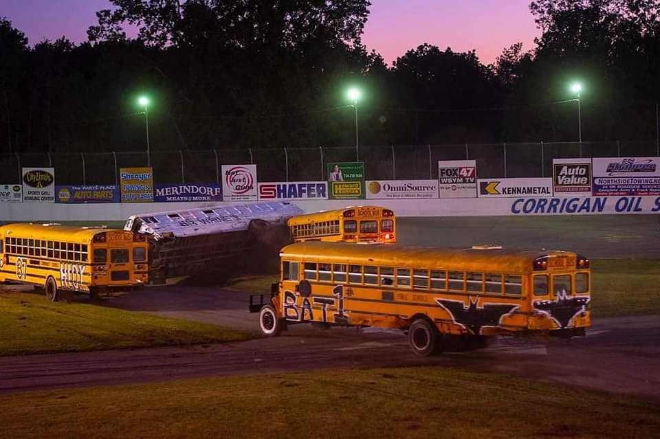 School buses on a race track.